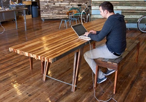 Man Sitting At Wooden DIY Table